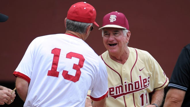 Indiana Hoosiers head coach Tracy Smith (13) meets with Florida State Seminoles head coach Mike Martin (11) before the start of the Tallahassee super regional of the 2013 NCAA baseball tournament at Dick Howser Stadium.
