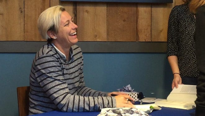 A line that stretched around the block greeted Abby Wambach as hundreds of fans lined up Friday night in Rochester to get their copy of her new book signed by the former soccer star from Pittsford.