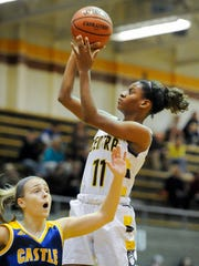 Central's Errin Hodges (11) shoots past Castle's Kaylie Stowe (24) during their game at Central High School in Evansville, Tuesday, Nov. 15, 2016.
