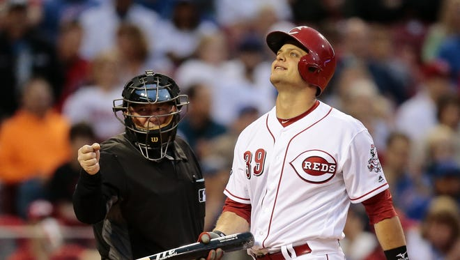 Reds catcher Devin Mesoraco flips his bat as he walks off from a strikeout during an April 21 game.