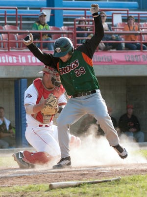 Bombers catcher Niko Pacheco tags Bullfrogs' Robb Paller out at home plate.