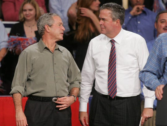 George W. Bush and Jeb Bush on Nov. 6, 2006, at a political