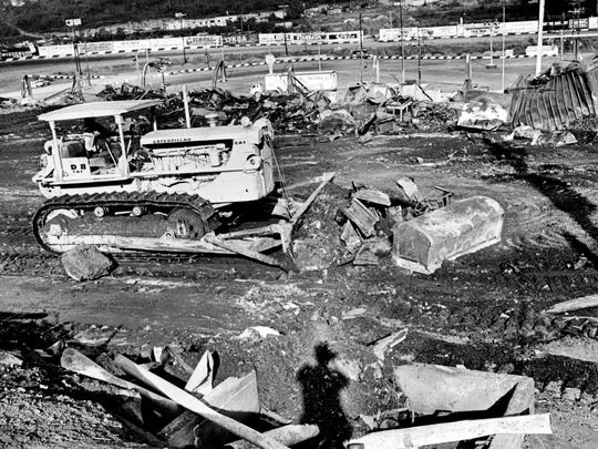 Cleanup operations continue in the destroyed pavilion area at the Tennessee State Fair Sept. 21, 1965. The coffin at right was one of a group on display in the Woman's Building before the fire on the first night of the fair.