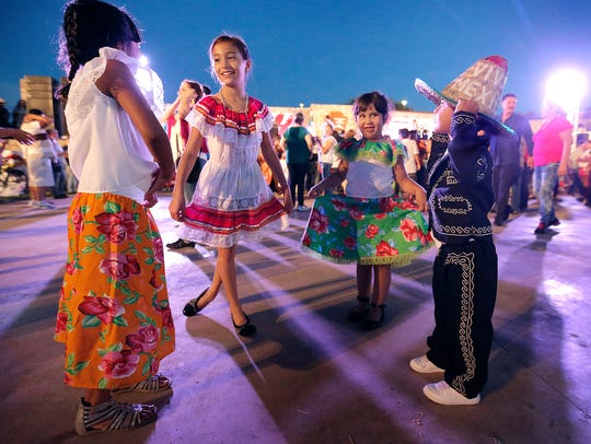 """Kids danced to traditional Mexican music as they awaited """"El Grito"""" during a 16 de Septiembre celebration at the Chamizal National Memorial."""