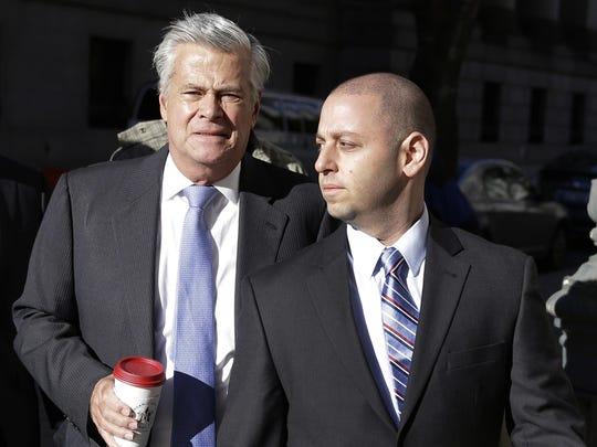New York Sen. Dean Skelos, left, and his son Adam Skelos