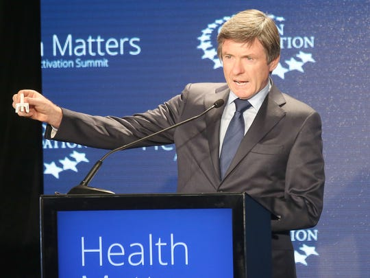Seamus Mulligan shows off his company's overdose drug during the Clinton Foundation's Health Matters summit in Indian Wells, January 26, 2016.