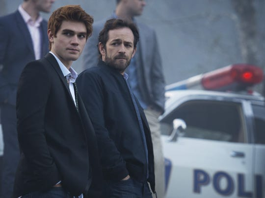 "K.J. Apa, left, as Archie Andrews, with Luke Perry as his father, Fred, in CW's ""Riverdale."""