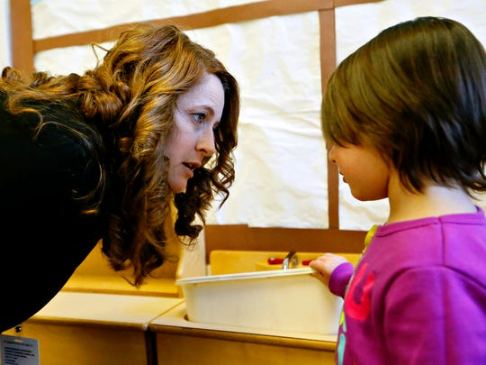 Substitute teacher Tabatha Peters, left, of West York Borough, listens to the concerns of student Lexi Mast, 4, during Community Progress Council's Head Start in York City, Friday, Dec. 15, 2016. Dawn J. Sagert photo