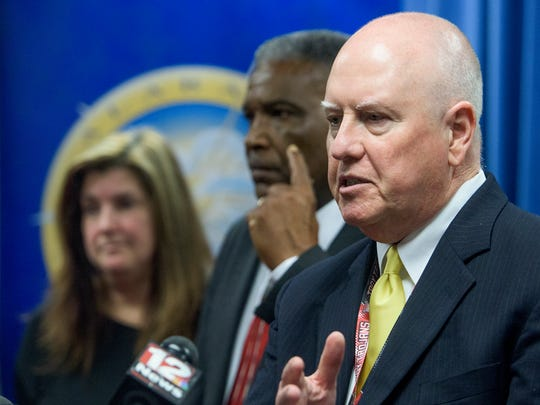 State Superintendent of Education Michael Sentance, foreground, speaks as Montgomery school board members Robert Porterfield and Lesa Keith look on following the meeting of the State Board of Education in Montgomery, Ala., on Wednesday January 12, 2016.