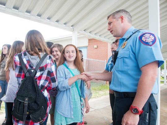 Seventh-grade violinist Grace Knapp, 12, thanks Capt.