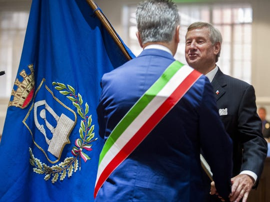 Montgomery Mayor Todd Strange is presented the flag of Pietrasanta, Italy, by Mayor Massimo Mallegni during the Mayoral and City Council Swearing-in Ceremony at the council auditorium in Montgomery on Nov. 10, 2015.