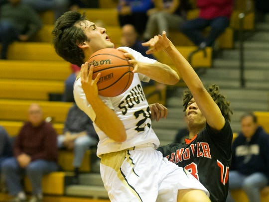 Delone Catholic's Evan Brady goes up for a shot, Tuesday,