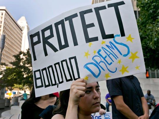 An unidentified student joins a rally Sept. 1, 2017, in support of the Deferred Action for Childhood Arrivals program, or DACA, outside the Edward Roybal Federal Building in downtown Los Angeles.