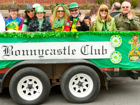 Members of the historic Bonnycastle Club wave in the St. Patrick's Day Parade in Louisville.