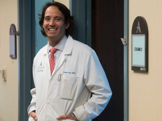 Dr. Adam Anz, an orthopaedic surgeon at Andrews Institute, talks about his stem cell research program on Wednesday.