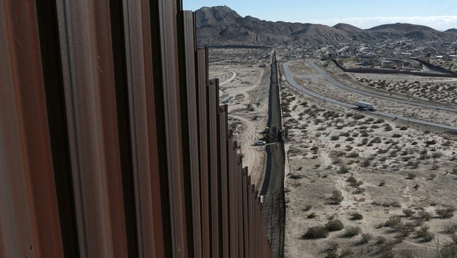 In this Jan. 25, 2017, file photo, a truck drives near the Mexico-US border fence, on the Mexican side, separating the towns of Anapra, Mexico and Sunland Park, New Mexico. White House budget documents show New Jersey companies want to help President Donald Trump build a wall.