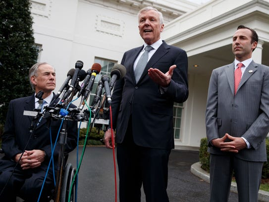 Charter Communications CEO Thomas Rutledge, center,