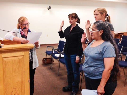 Erin Johnson, left, swears in Town Planner Jaime Embick, Teresa Dahl-Bredine and Mary Ellen Marquez prior to Tuesday's public hearings at the Silver City Planning and Zoning Commission meeting. Randal Seyler - Sun-News