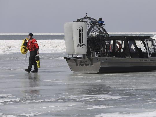 Emergency personnel prepare to rescue stranded fishermen
