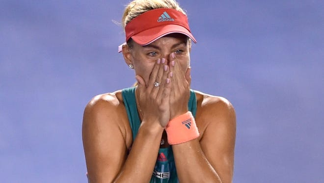 Angelique Kerber of Germany celebrates after her victory over Serena Williams of the US in their women's singles final match during the Australian Open on Jan. 30, 2016.