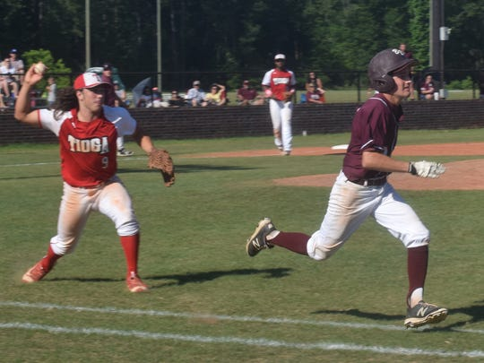 Tioga pitcher Corbin Malon (9, left) throws to first for an out against Breaux Bridge's Noah Frederick (18, right) in a home playoff game held Saturday.