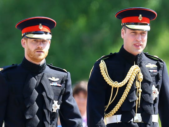 Prince Harry, left, arrives at his wedding to Meghan