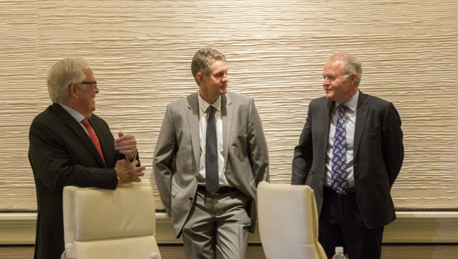 Murray Craven, center, has been working with owner Bill Foley, left, and Peter Sadowski from Fidelity National Financial, another company of Foley's.