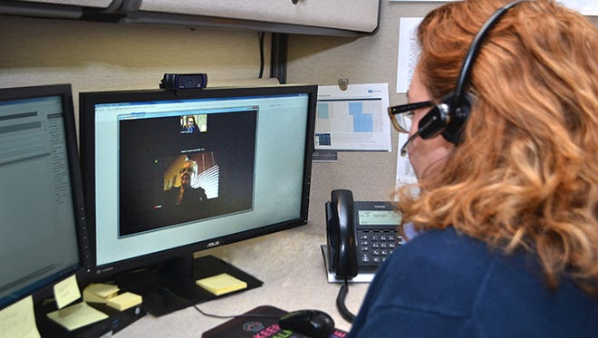 """Karen Gugala of Northville works the triage center at Angela Hospice. A new """"telehospice"""" program allows patients to video chat with nurses."""