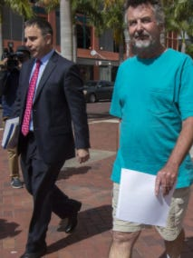 """Attorney Todd Foster and VR Labs scandal co-defendant John G. Williams leave Fort Myers Federal Court after 2017 arraignment. Foster has filed papers accusing VR Labs principals Kay and Robert Gow of trying to donate """"virtually worthless"""" artwork to a Naples museum and taking lavish vacations with corporate funds."""