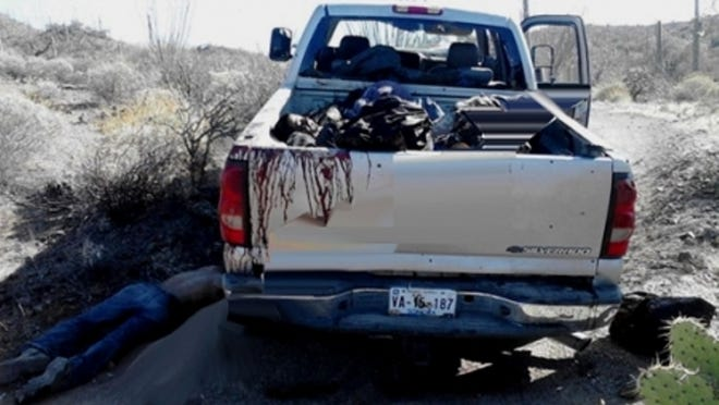 The aftermath of an ambush that killed 7 near the Arizona-Mexico border on March 20, 2014.