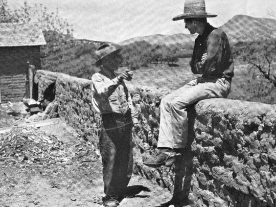 From the pictured adobe wall, Billy the Kid is said to have ambushed Sheriff William J. Brady. Don Francisco Gomez, who worked in the Tunstall store at the time of the incident, was showing artist Peter Hurd of San Patricio the direction from which the sheriff was coming when he was shot. The photo appeared in LIFE magazine in 1939.