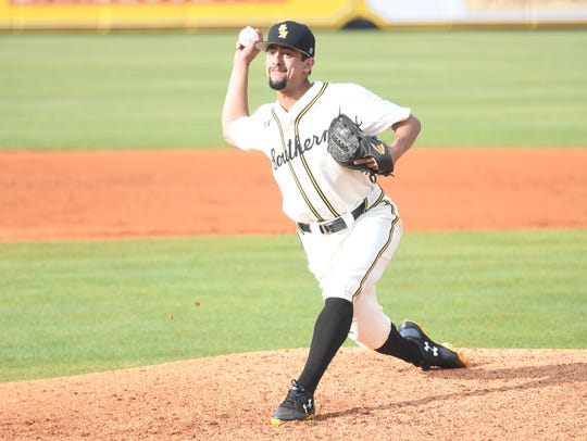Southern Miss pitcher Nick Sandlin delivers to the