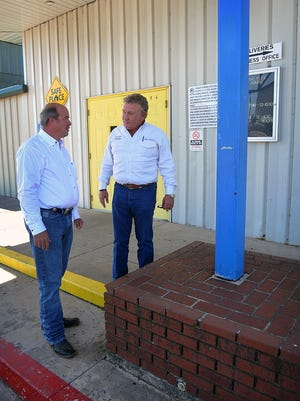 Kenny Nordeen, left, and Harry Patterson talk about the remodeling and renovations coming soon at the Family Fun Zone, formerly The Plex. The front of the building will get a new stone facade and columns.