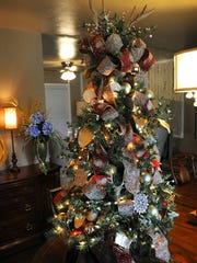 A 4-foot Christmas tree decorated by Chip Kouri features