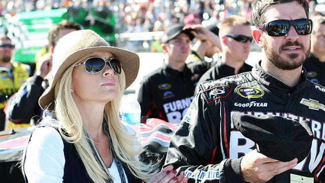 Martin Truex Jr. (78) with his girlfriend Sherry Pollex during the National Anthem before the Goody's Headache Relief Shot 500 at Martinsville Speedway on Sunday.