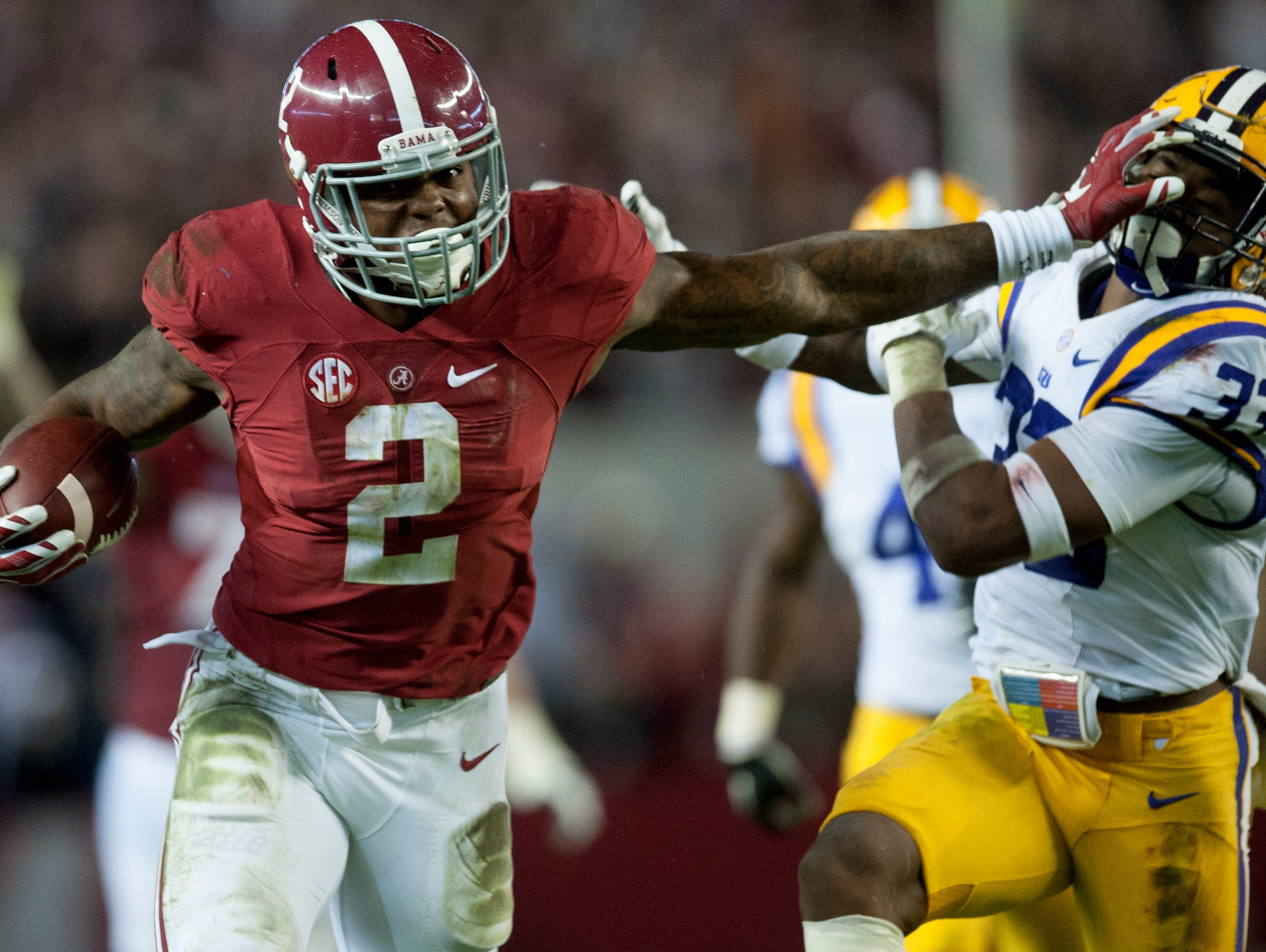 Alabama running back Derrick Henry (2) stiff arms LSU safety Jamal Adams (33) on a long gainer in the second quarter at Bryant-Denny Stadium in Tuscaloosa, Ala. on Saturday November 7, 2015