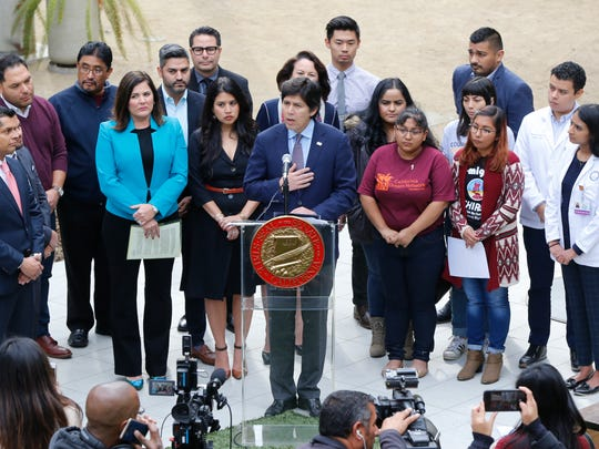 "Senate President pro Tempore Kevin de Leon (D-Los Angeles), center at podium, holds a news conference with a broad coalition in support of the DREAM Act, to urge its passage next week before Congress recesses for the holidays in Los Angeles Wednesday, Dec. 20, 2017. The Deferred Action for Childhood Arrivals, DACA policy, includes about 800,000 of college-age students, commonly referred to as ""dreamers,"" based on never-passed proposals in Congress called the DREAM Act that would have provided similar protections for young immigrants. U.S. District Judge William Alsup granted a request by California and other plaintiffs to prevent President Donald Trump from ending the Deferred Action for Childhood Arrivals program while their lawsuits play out in court."