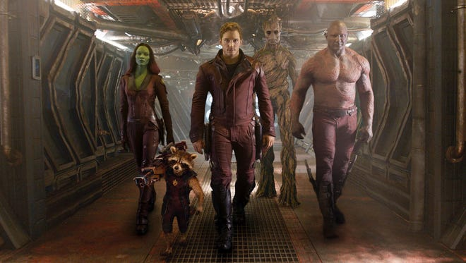 The 'Guardians of the Galaxy' crew, from left:  Zoe Saldana, Rocket Racoon (voiced by Bradley Cooper), Chris Pratt,  tree-creature Groot (voiced by Vin Diesel) and Dave Bautista.