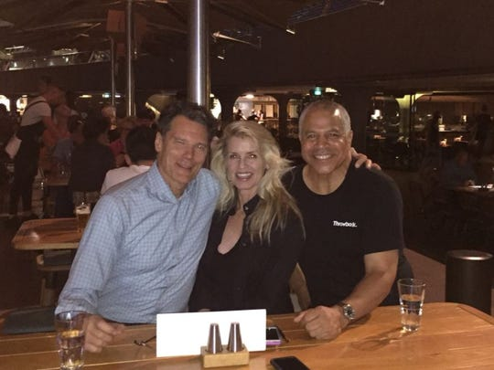 Jon Darsee, left, and his wife Polly recently spent time with former Hawkeye teammate Steve Carfino, right, in Australia.