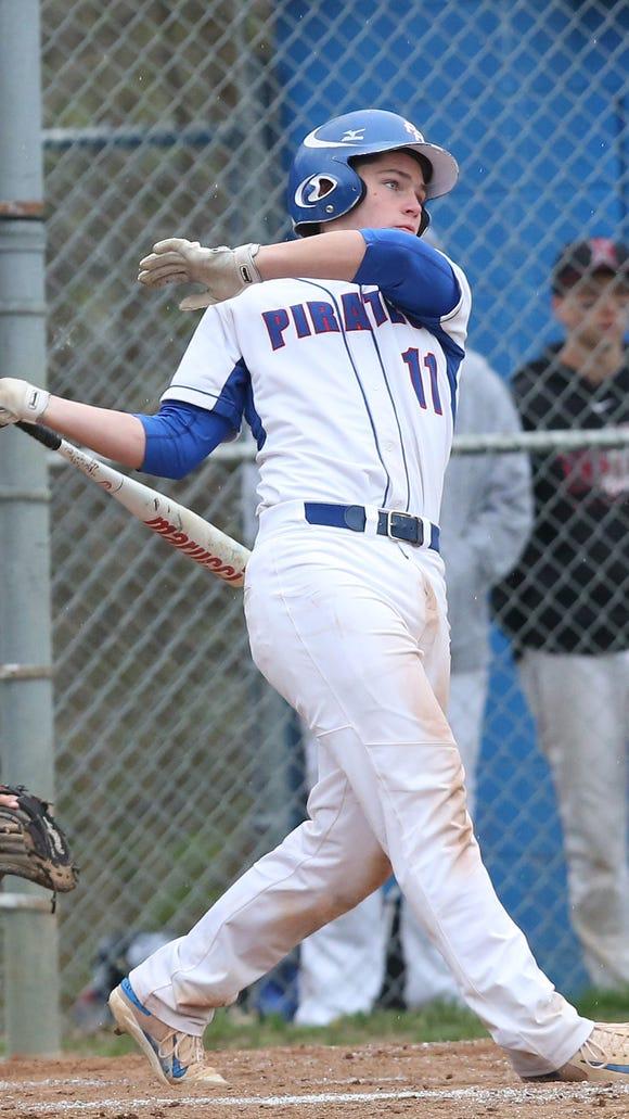 Pearl River's Sean Flaherty (11) hits a 3-run home run against Nyack during boys baseball action at Pearl River High School April 19,  2017. Pearl River won the game 12-0.