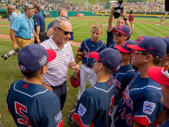 Rob Manfred, Commissioner of Major League Baseball, second from left, meets the Maine-Endwell Little League Team Monday before their 3-0 win over Goodlettsville.