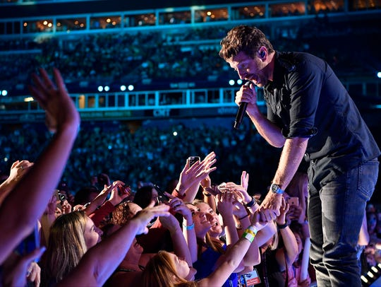 Brett Eldredge interacts with the crowd as he performs