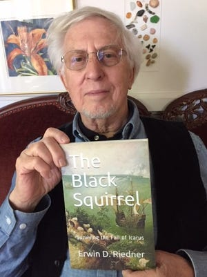 "Erwin Riedner of Wooster displays his latest book, ""The Black Squirrel."""