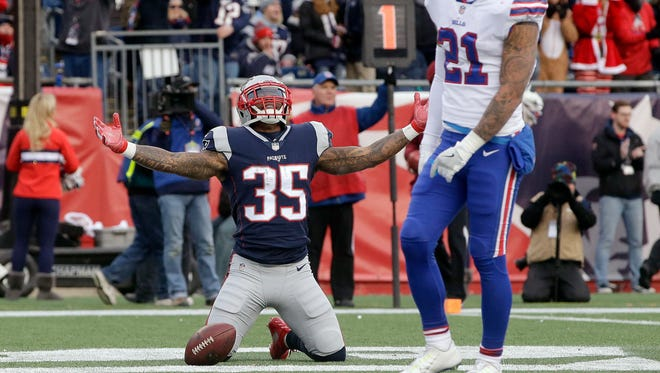 New England Patriots running back Mike Gillislee (35) celebrates his touchdown beside Buffalo Bills safety Jordan Poyer (21) during the second half of an NFL football game, Sunday, Dec. 24, 2017, in Foxborough, Mass. (AP Photo/Steven Senne)