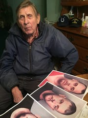 Billy Smiley, 87, Indianapolis, sits in front of mugshots