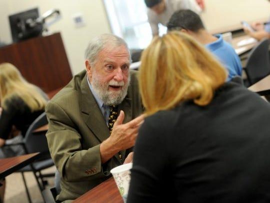 Dr. Frank Ochberg talks with an attendee at a trauma