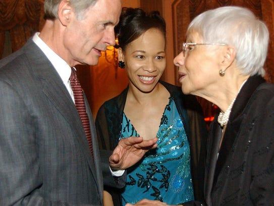U.S. Sen. Tom Carper talks with Louise Gilliam, mother