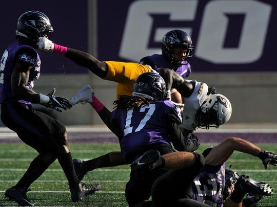 Abilene Christian University's Jamar Mack tackles Southeastern Louisiana University's Juwan Petit-Frere during Saturday's game Oct. 21, 2017. Southeastern Louisiana won, 56-21.