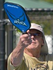 Jim Albers returns a serve.