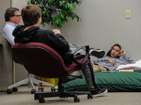 Clinical psychologist Paul Case, talks with students Jack Taylor, left, and Owen Rockenbach, in their weekly therapy session, Thursday November 10, 2016, at the Ridgecrest Academy in Nashville, Tenn.